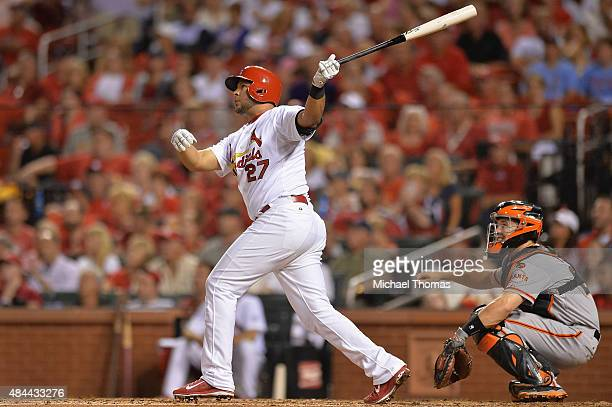 Jhonny Peralta of the St Louis Cardinals hits a double in the fourth inning against the San Francisco Giants at Busch Stadium on August 18 2015 in St...