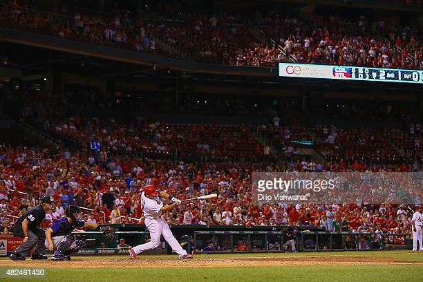 Jhonny Peralta of the St Louis Cardinals hits a gametying RBI single against the Colorado Rockies in the ninth inning at Busch Stadium on July 30...