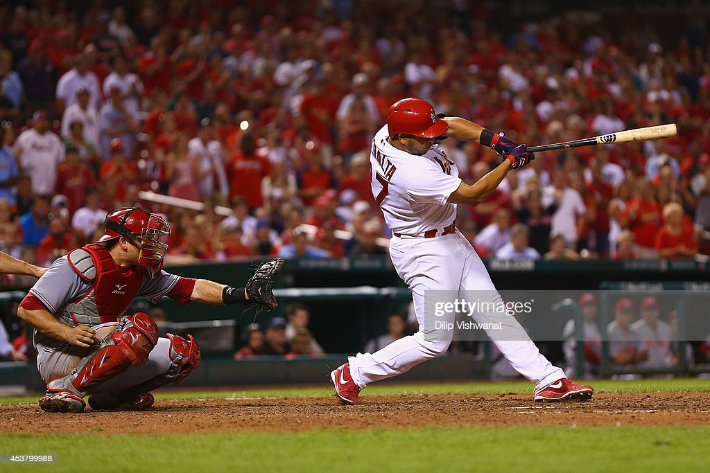 <a gi-track='captionPersonalityLinkClicked' href=/galleries/search?phrase=Jhonny+Peralta&family=editorial&specificpeople=213286 ng-click='$event.stopPropagation()'>Jhonny Peralta</a> #27 of the St. Louis Cardinals hits the game-winning RBI single against the Cincinnati Reds in the tenth inning at Busch Stadium on August 18, 2014 in St. Louis, Missouri. The Cardinals beat the Reds in 10 innings.