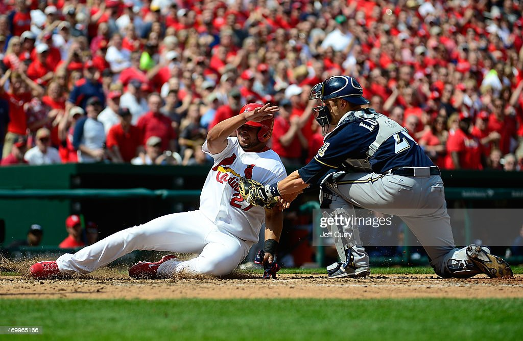 <a gi-track='captionPersonalityLinkClicked' href=/galleries/search?phrase=Jhonny+Peralta&family=editorial&specificpeople=213286 ng-click='$event.stopPropagation()'>Jhonny Peralta</a> #27 of the St. Louis Cardinals is tagged out by <a gi-track='captionPersonalityLinkClicked' href=/galleries/search?phrase=Jonathan+Lucroy&family=editorial&specificpeople=5732413 ng-click='$event.stopPropagation()'>Jonathan Lucroy</a> #20 of the Milwaukee Brewers during the sixth inning at Busch Stadium on April 16, 2015 in St. Louis, Missouri.