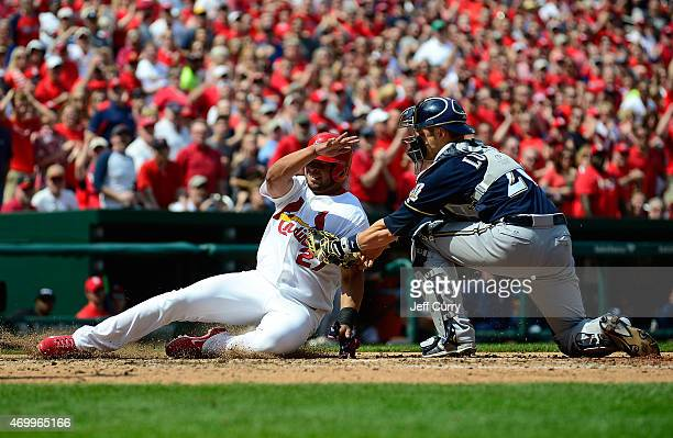 Jhonny Peralta of the St Louis Cardinals is tagged out by Jonathan Lucroy of the Milwaukee Brewers during the sixth inning at Busch Stadium on April...
