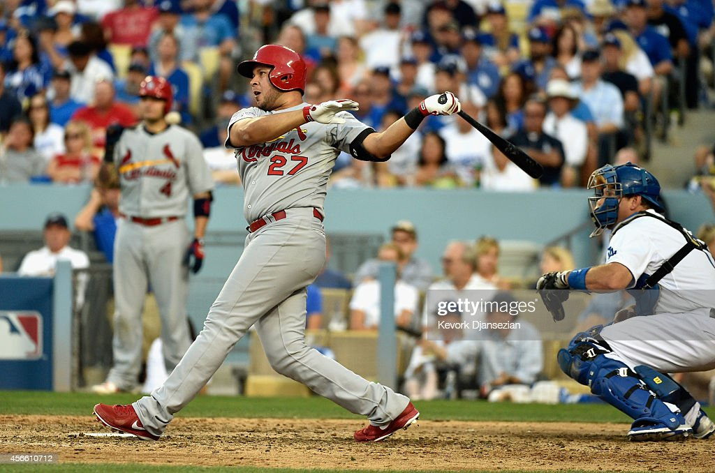 <a gi-track='captionPersonalityLinkClicked' href=/galleries/search?phrase=Jhonny+Peralta&family=editorial&specificpeople=213286 ng-click='$event.stopPropagation()'>Jhonny Peralta</a> #27 outfield the St. Louis Cardinals hits a single in the seventh inning against the Los Angeles Dodgers during Game One of the National League Division Series at Dodger Stadium on October 3, 2014 in Los Angeles, California.