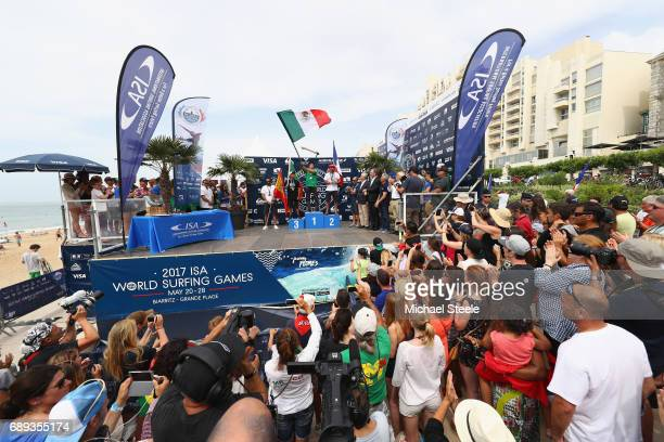 Jhony Corzo of Mexico winner of the Men's Final waves the flag alongside silver medalist Joan Daru of France and bronze medalist Pedro Henrique of...