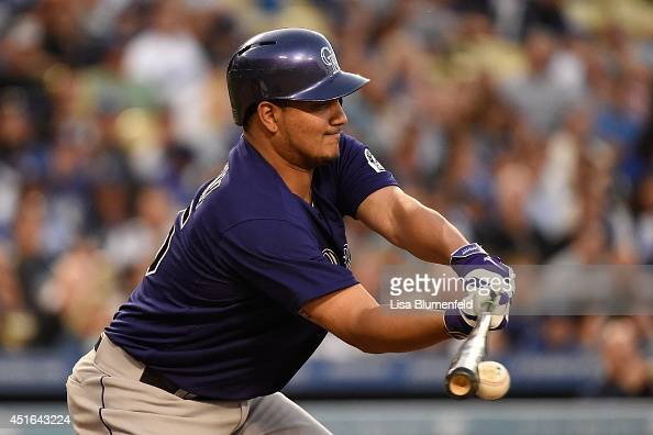 Jhoulys Chacin of the Colorado Rockies bats against the Los Angeles Dodgers at Dodger Stadium on June 17 2014 in Los Angeles California