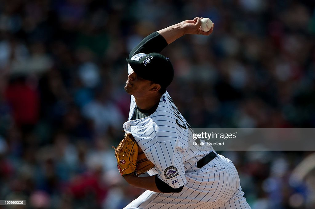Jhoulys Chacin #45 of the Colorado Rockies pitches in the fourth inning against the San Diego Padres at Coors Field on April 7, 2013 in Denver, Colorado. The Rockies beat the Padres 9-1.