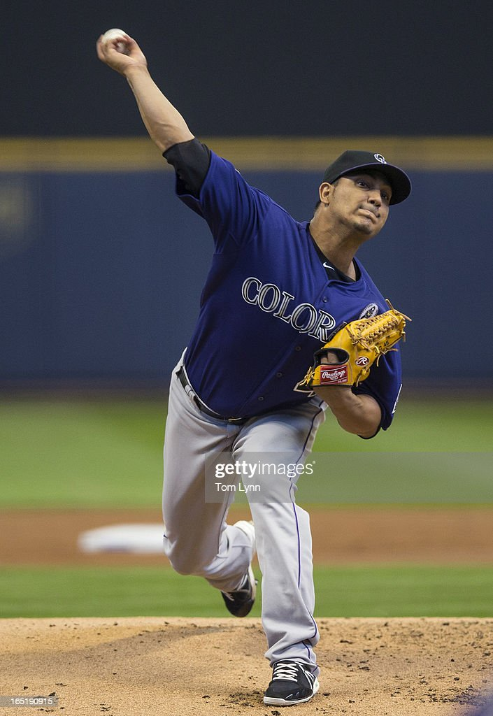 Jhoulys Chacin #45 of the Colorado Rockies pitches to a Milwaukee Brewers batter during the first inning on opening day at Miller Park on April 1, 2013 in Milwaukee, Wisconsin.