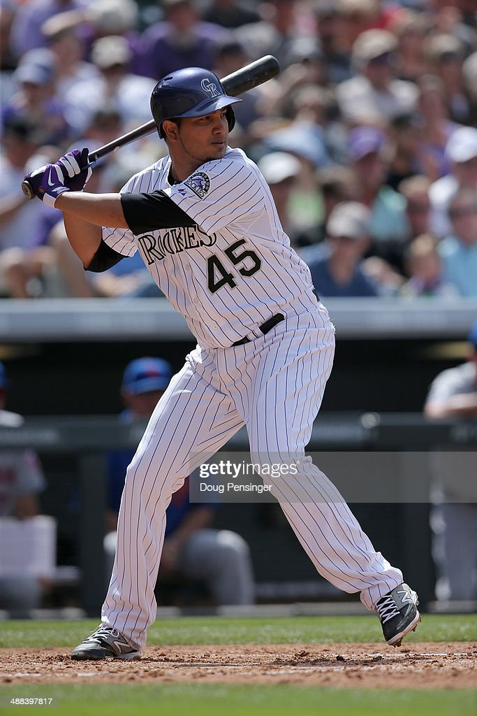 Jhoulys Chacin of the Colorado Rockies takes an at bat against New York Mets at Coors Field on May 4 2014 in Denver Colorado The Mets defeated the...