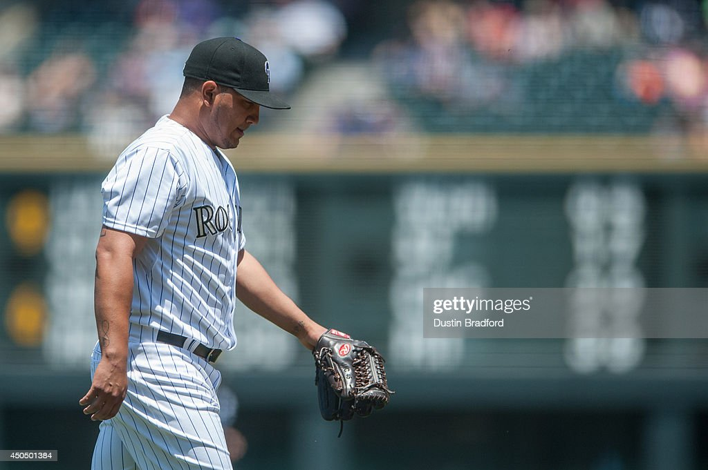 Jhoulys Chacin of the Colorado Rockies walks off the mound after pitching against the Atlanta Braves in the first inning of a game at Coors Field on...