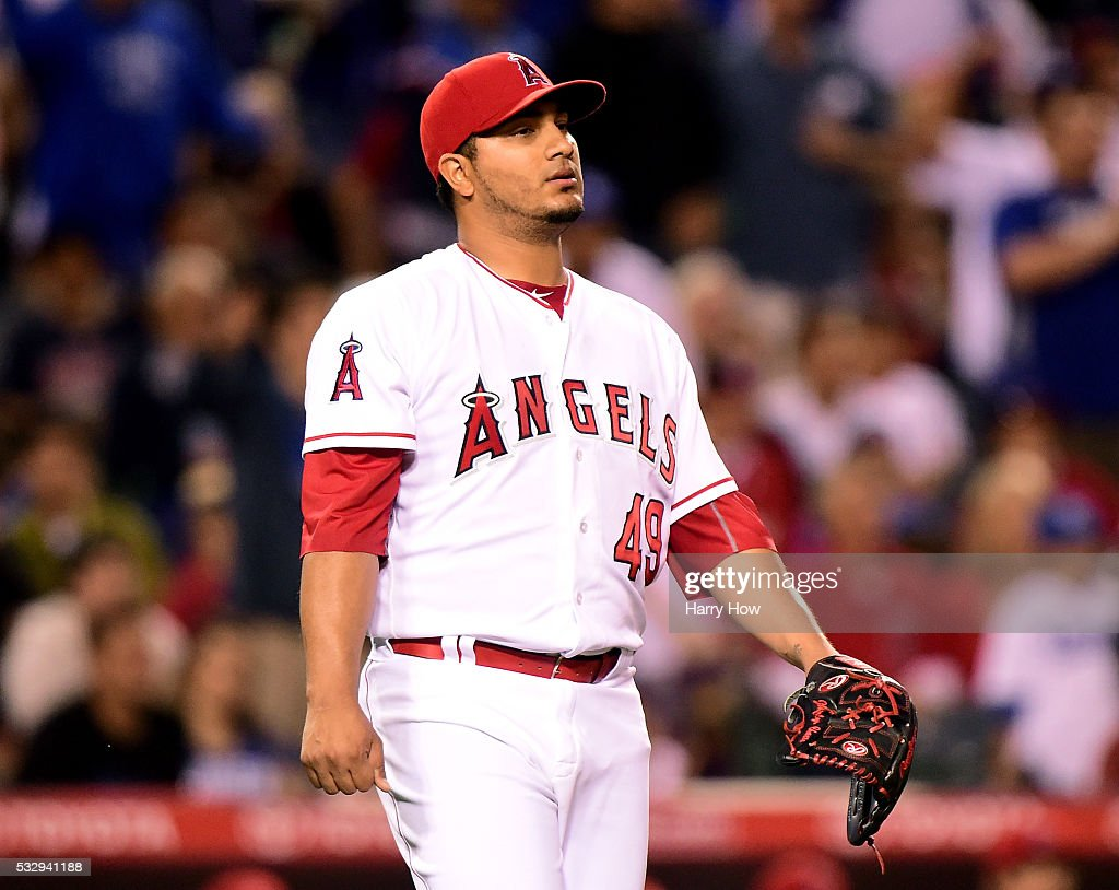Jhoulys Chacin of the Los Angeles Angels reacts as he gives up a triple to Howie Kendrick of the Los Angeles Dodgers to score to run to trail 31...