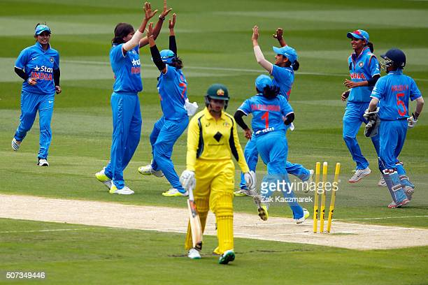 Jhulan Goswami celebrates with her team after Grace Harris of Australia is bowled out by Jhulan Goswami of India during the women's Twenty20...