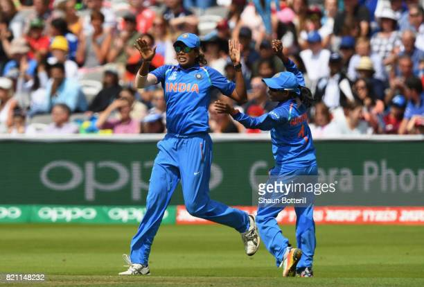Jhulan Goswami is congratulated by teammate Rajeshwari Gayakwad after taking a catch during the ICC Women's World Cup 2017 Final between England and...