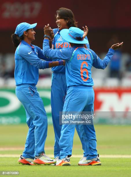 Jhulan Goswami of India celebrates taking the wicket of Rachel Priest of New Zealand with team mates Harmanpreet Kaur of India and Deepti Sharma of...