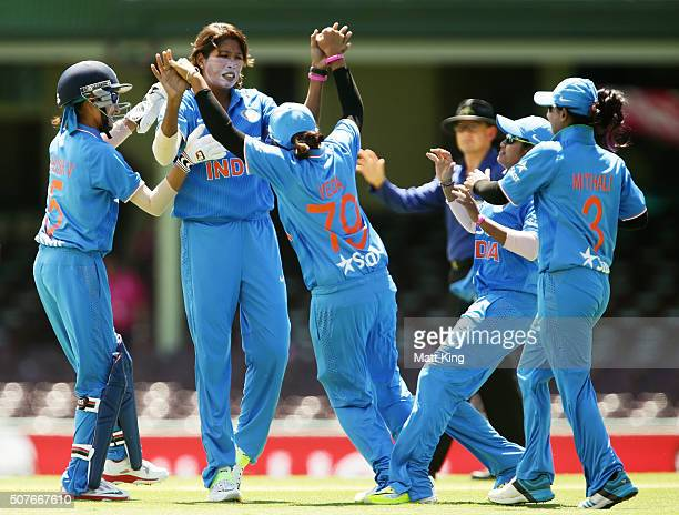 Jhulan Goswami of India celebrates with team mates after taking the wicket of Alyssa Healy of Australia from the first ball of the match during the...