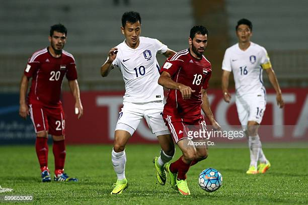 Ji Dong Won of South Korea battles with Mhd Zahir of Syria during the 2018 FIFA World Cup Qualifier Final Round Group A match between Syria and South...