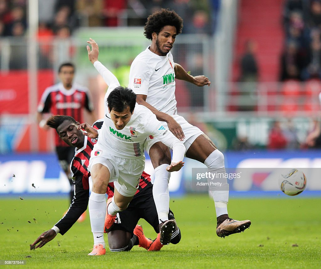Ji Dong-Won and Caiuby of Augsburg challenge Danny da Costa of Ingolstadt 04 during the Bundesliga match between FC Ingolstadt and FC Augsburg at Audi Sportpark on February 6, 2016 in Ingolstadt, Germany.