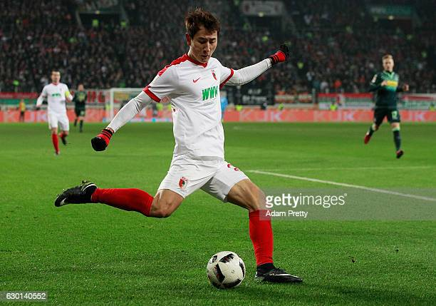 Ji DongWon of Augsburg in action during the Bundesliga match between FC Augsburg and Borussia Moenchengladbach at WWK Arena on December 17 2016 in...