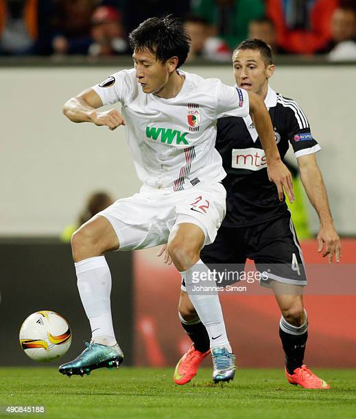 Ji DongWon of Augsburg vies with Miroslav Vulicevic of Partizan during the UEFA Europa League group L football match FC Ausburg vs FK Partizan at WWK...
