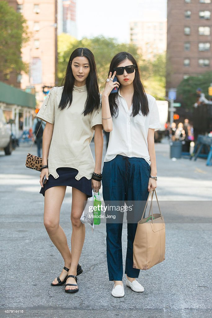 Ji Hye Park and Sung Hee Kim exit Richard Chai on Day 1 of New York Fashion Week Spring/Summer 2015 on September 4, 2014 at Lincoln Center in New York City. Ji Hye wears a Soonil outfit, Sung Hee wears Karl Lagerfeld sunglasses, Band of Outsiders pants, and Tod's gommimo shoes.