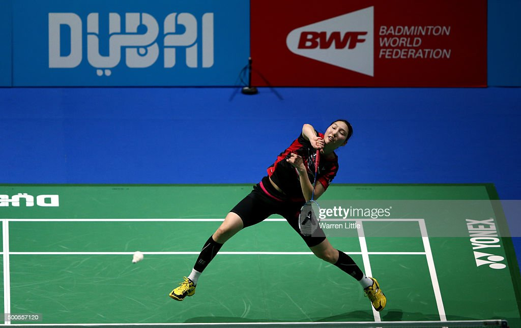 Ji Hyun Sung of Korea in action against Ratchanok Intanon of Thailand during day one of the BWF Dubai World Superseries 2015 Finals at the Hamdan Sports Complex on on December 9, 2015 in Dubai, United Arab Emirates.