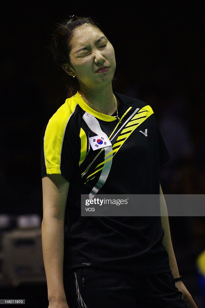 Ji Hyun Sung of South Korea reacts during her semi-final match against Sayaka Sato of Japan during the Ube Cup world badminton team championships at Wuhan Sports Gymnasium Center on May 24, 2012 in Wuhan, China.