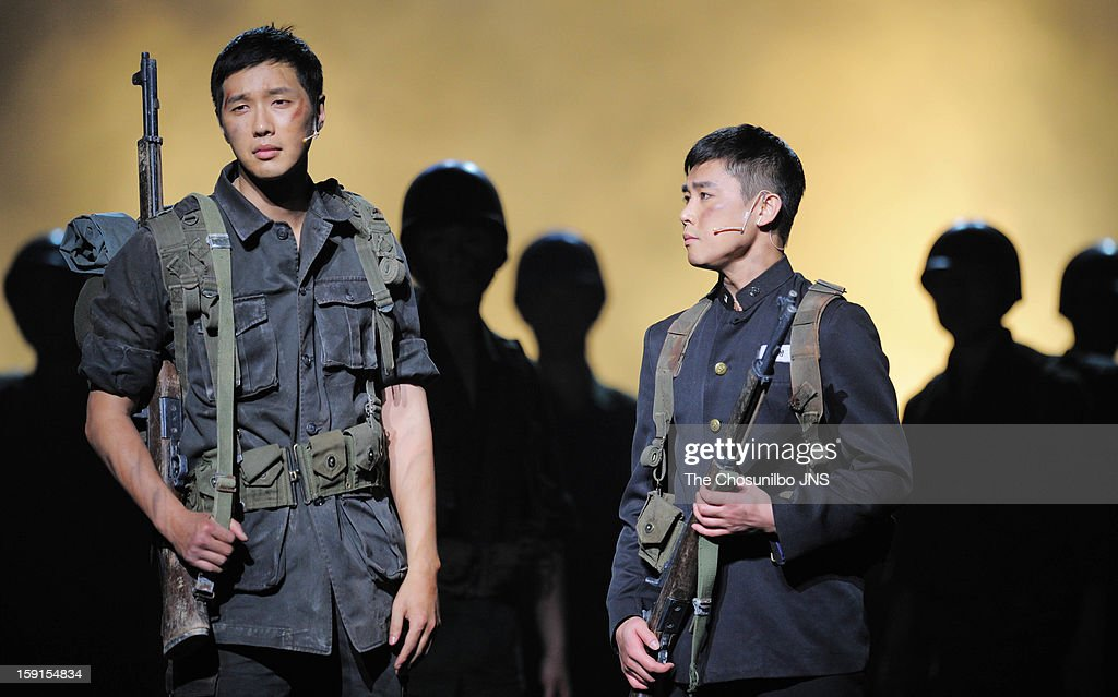 Ji Hyun-Woo and Jung Tae-Woo perform during the musical 'The Promise' press call at the National Theater of Korea Main Hall 'Hae' on January 8, 2013 in Seoul, South Korea.