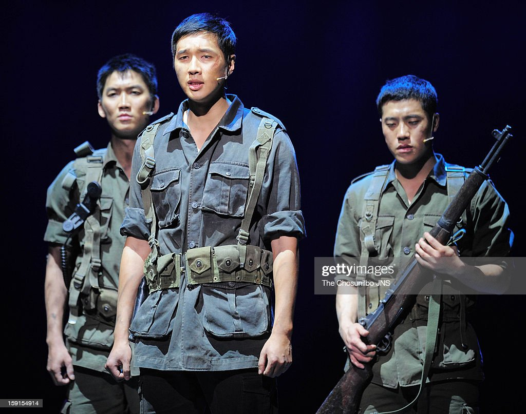 Ji Hyun-Woo (c) performs during the musical 'The Promise' press call at the National Theater of Korea Main Hall 'Hae' on January 8, 2013 in Seoul, South Korea.