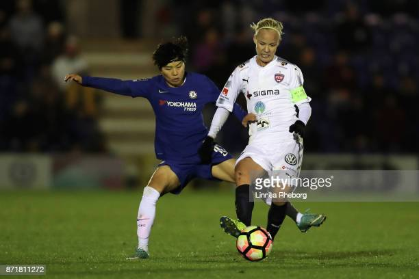 Ji So Yun of Chelsea and Caroline Seger of Rosengard battle for possession during the UEFA Women's Champions League match between Chelsea Ladies and...