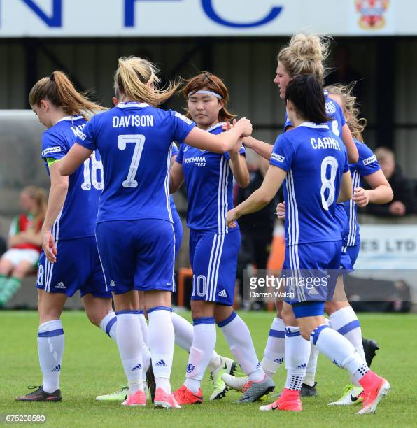 Ji So Yun of Chelsea celebrates with her team mates after she scores from a free kick to put her side 10 up during the FA WSL 1 match between Chelsea...
