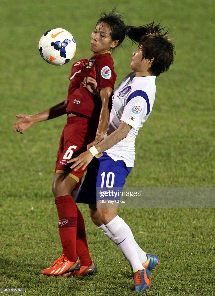 Ji So Yun of Korea Republic battles with Pikul Khueanpet of Thailand during the AFC Women's Asian Cup Gropu B match between Thailand and Korea Republic at Thong Nhat Stadium on May 17, 2014 in Ho Chi Minh City, Vietnam.