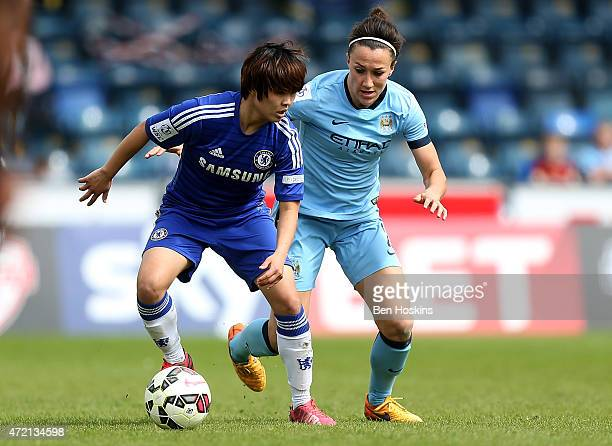 Ji SoYun of Chelsea holds off pressure from Lucy Bronze of Manchester City during the Women's FA Cup Semi Final match between Chelsea Ladies and...