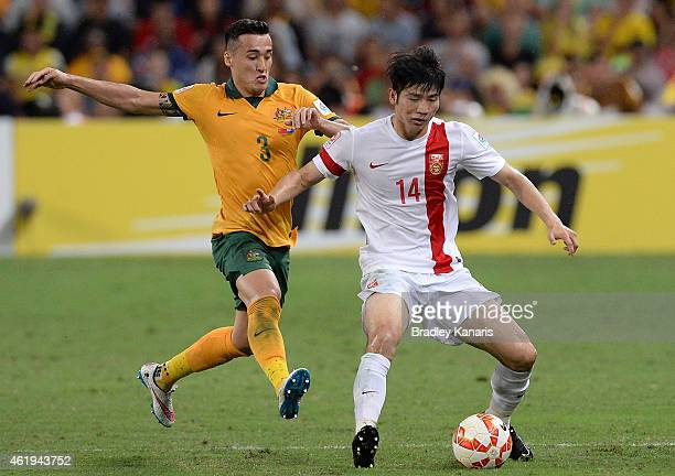 Ji Xiang of China is challenged by Jason Davidson of Australia during the 2015 Asian Cup match between China PR and the Australian Socceroos at...