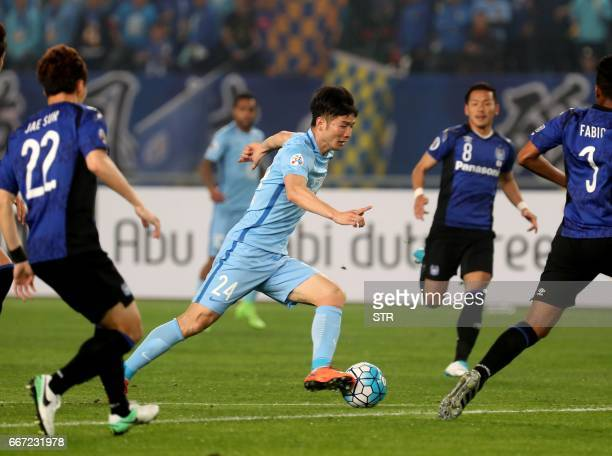 Ji Xiang of Jiangsu FC controls the ball during the AFC Champions League group stage football match against Japan's Gamba Osaka in Nanjing east...