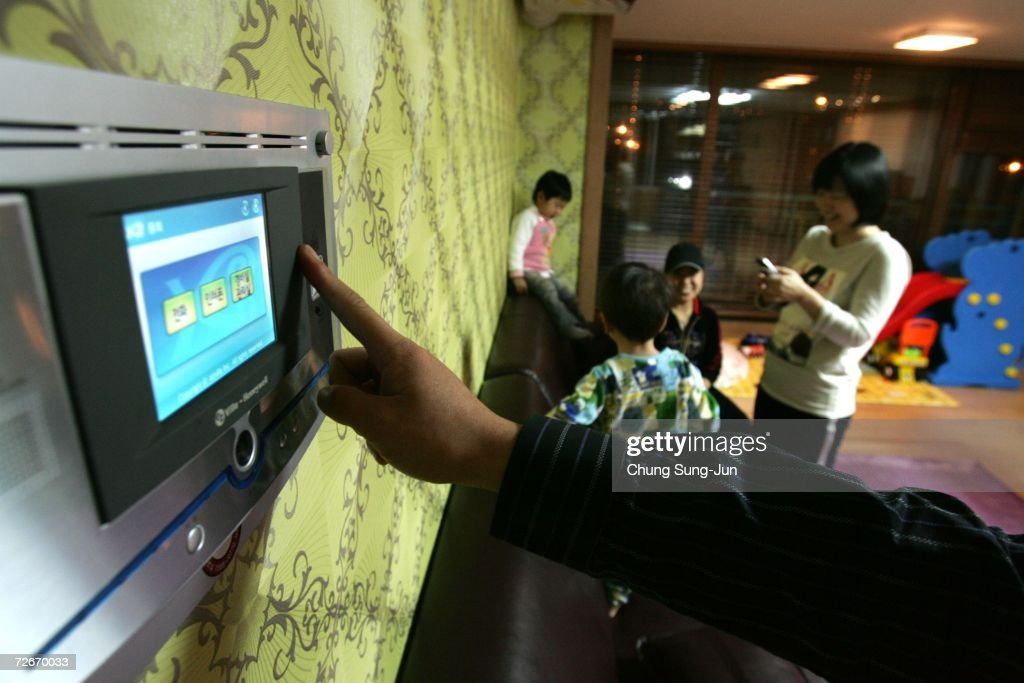Ji Young-Hoon (34), controls an electronic appliance in his house using a control panel on November 29, 2006 in Incheon, South Korea. The Home Network uses advanced technology to improve quality of life by enabling communication between the resident and their home by using remote devices. South Korea's vision of the home of the future will include wearing of mini-PCs on our wrists to control things in the home, open doors, and track the wearer's position in the house at all times. South Korea's Ministry of Information and Communication will try to use 'Ubiquitous Digital Life' to turn the country into a 'Ubiquitous Society' where computers and the internet are available anytime and anywhere. South Korea has the largest broadband market in the world with more than half of South Korean households equipped with high-speed Internet connections.
