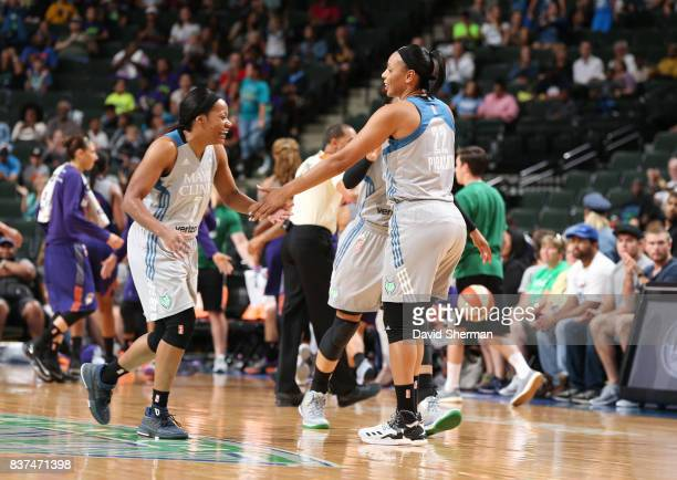 Jia Perkins and Plenette Pierson of the Minnesota Lynx shake hands during the game against the Phoenix Mercury on August 22 2017 at Xcel Energy...