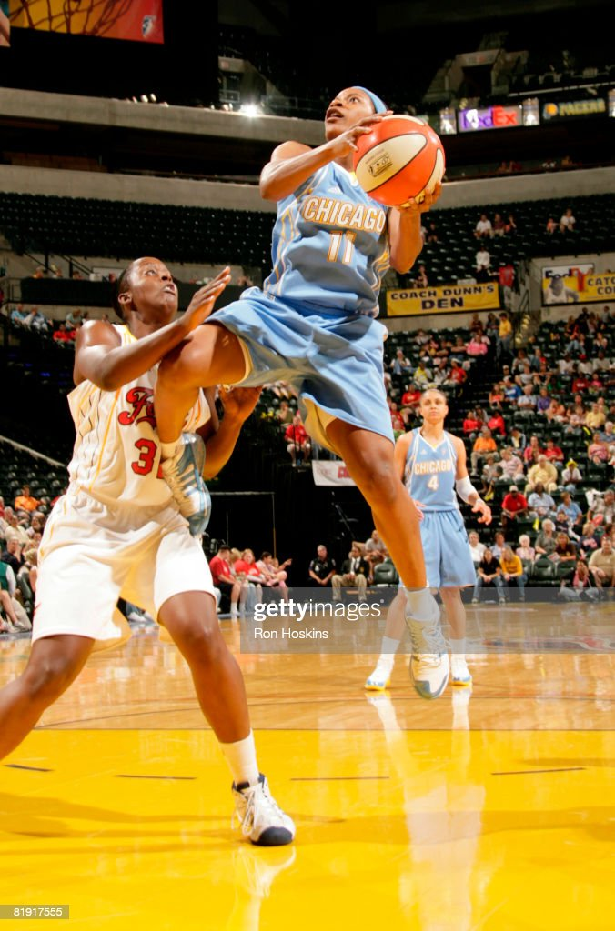 Jia Perkins of the Chicago Sky shoots over Ebony Hoffman of the Indiana Fever at Conseco Fieldhouse on July 12 2008 in Indianapolis Indiana The Fever...