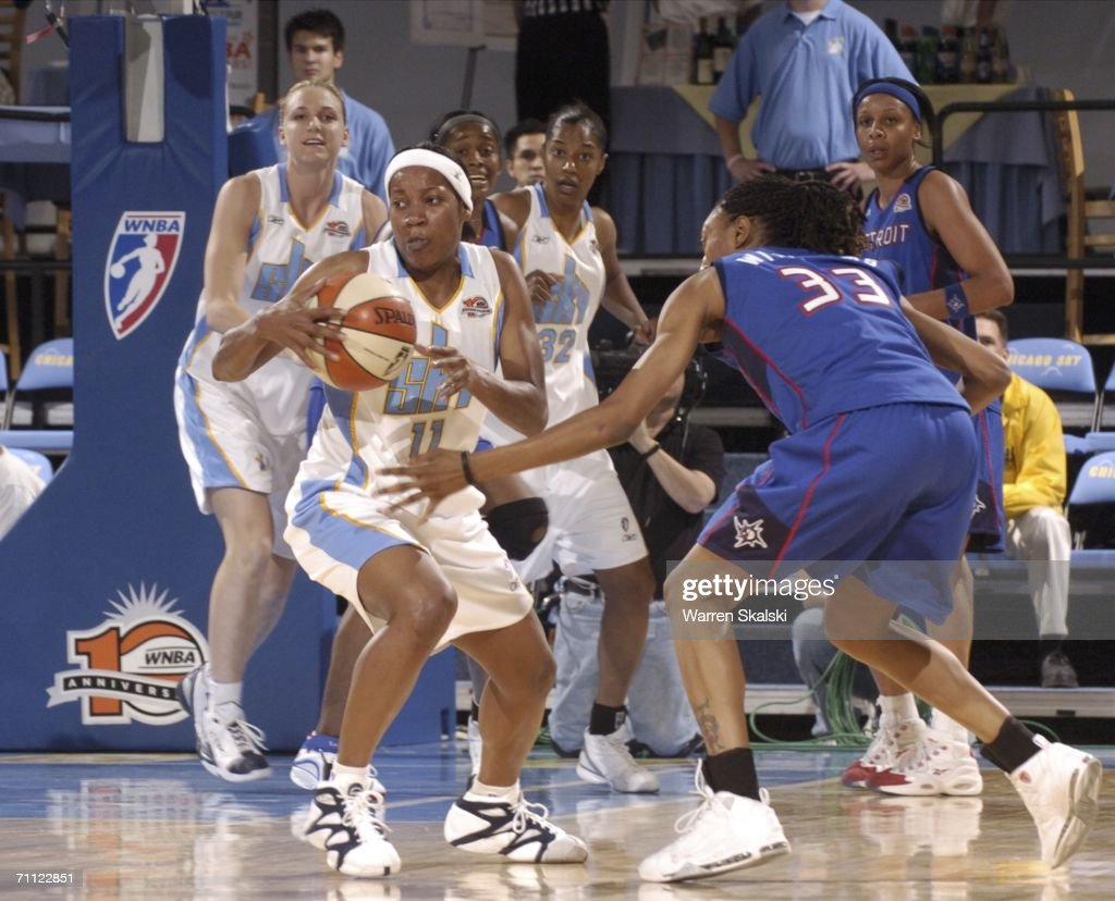 Jia Perkins of the Chicago Sky steals the ball from Angelina Williams of the Detroit Shock June 4 2006 at the UIC Pavilion in Chicago Illinois...