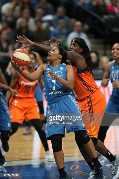 Jia Perkins of the Minnesota Lynx handles the ball against the Connecticut Sun on May 23 2017 at Xcel Energy Center in St Paul Minnesota NOTE TO USER...