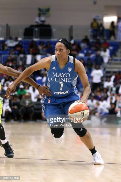 Jia Perkins of the Minnesota Lynx handles the ball during the game against the Dallas Wings in a WNBA game on May 20 2017 at College Park Center in...