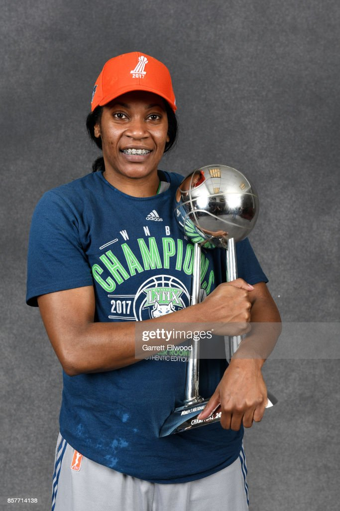 Jia Perkins #7 of the Minnesota Lynx poses for a portrait while holding the 2017 WNBA Championship trophy after the game against the Los Angeles Sparks in Game Five of the 2017 WNBA Finals on October 4, 2017 in Minneapolis, Minnesota. NOTE