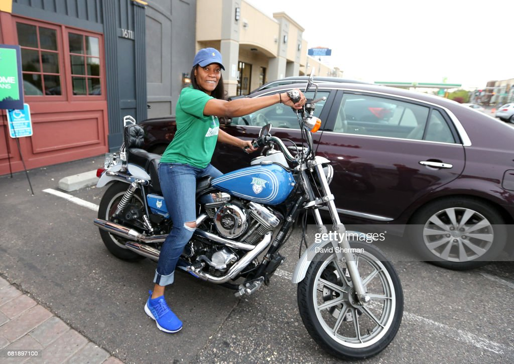 Jia Perkins #7 of the Minnesota Lynx poses on a motorcycle during a fundraiser to raise money for the Lynx FastBreak Foundation, which provides and supports hands-on programs for Minnesota youth on May 9, 2017 at Stouts Pub in St. Paul, Minnesota.