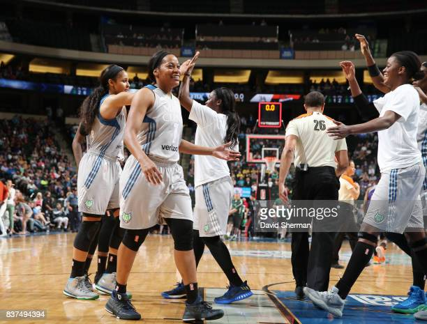 Jia Perkins of the Minnesota Lynx shakes hands with teammates during the game against the Phoenix Mercury on August 22 2017 at Xcel Energy Center in...