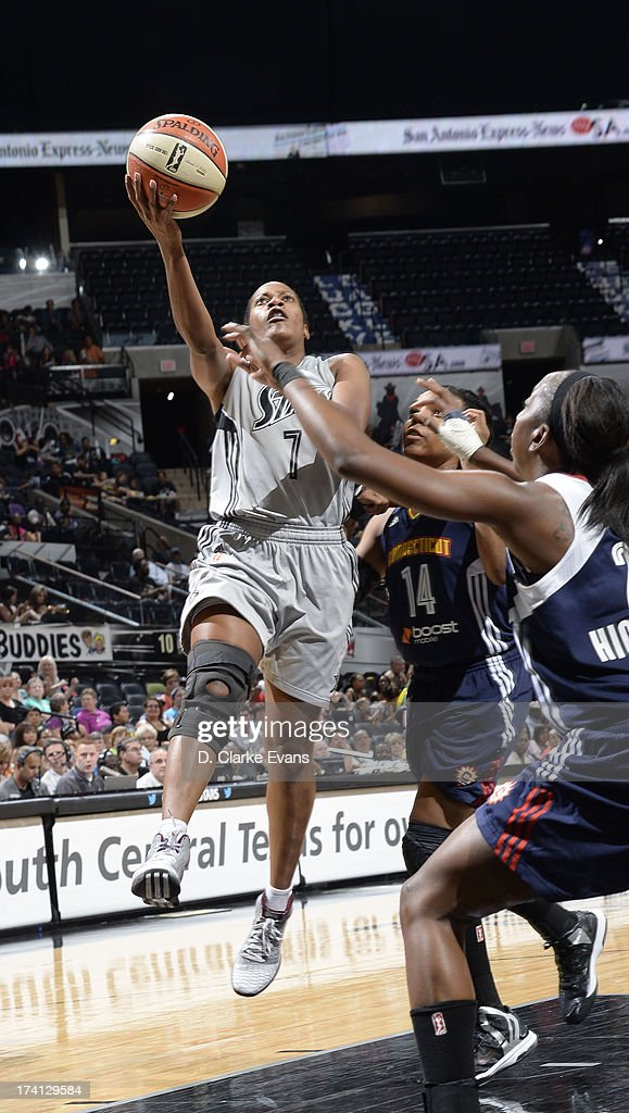 <a gi-track='captionPersonalityLinkClicked' href=/galleries/search?phrase=Jia+Perkins&family=editorial&specificpeople=544628 ng-click='$event.stopPropagation()'>Jia Perkins</a> #7 of the San Antonio Silver Stars shoots against <a gi-track='captionPersonalityLinkClicked' href=/galleries/search?phrase=Tan+White&family=editorial&specificpeople=110087 ng-click='$event.stopPropagation()'>Tan White</a> #14 of the Connecticut Sun at the AT&T Center on July 20, 2013 in San Antonio, Texas.
