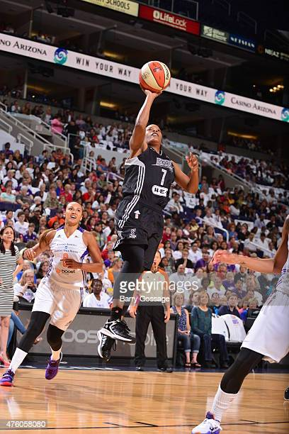 Jia Perkins of the San Antonio Stars goes to the basket against the Phoenix Mercury on June 5 2015 at the Talking Stick Resort Arena in Phoenix...