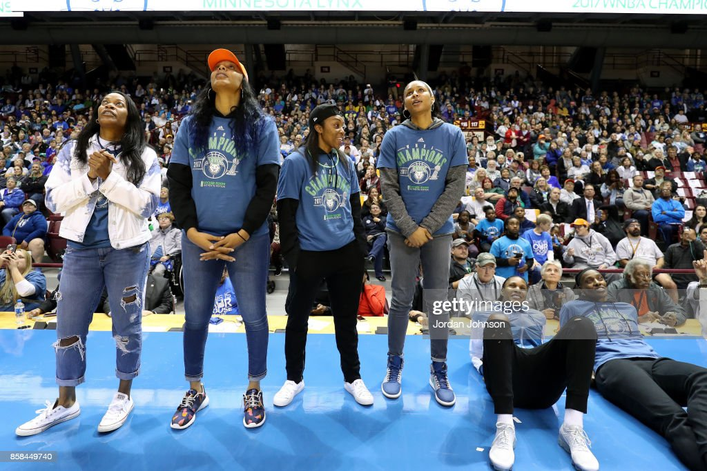 Jia Perkins #7, Plenette Pierson #22, Renee Montgomery #21, Maya Moore #23, Rebekkah Brunson #32 and Sylvia Fowles #34 of the Minnesota Lynx look on during the Minnesota Lynx title parade on October 5, 2017 at The University of Minnesota Williams Arena in Minneapolis, Minnesota.