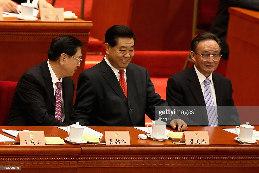 Jia Qinglin (Center), chairman of the Chinese People's Political Consultative Conference, reacts after delivering a speech at the opening session of the Chinese People's Political Consultative Conference in Beijing's Great Hall of the People on March 3, 2013 in Beijing, China. Over 2,000 members of the 12th National Committee of the Chinese People's Political Consultative, a political advisory body, are attending the annual session, during which they will discuss the development of China.
