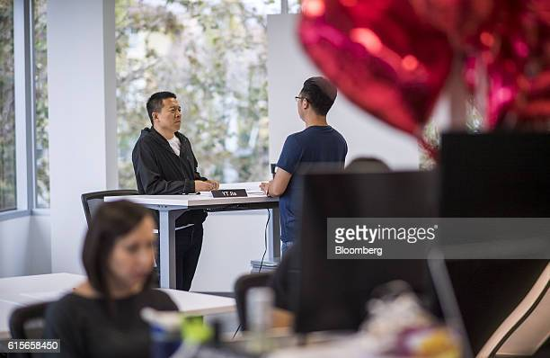 Jia 'YT' Yueting chief executive officer of LeEco Global Group left speaks with an employee at the company's headquarters in San Jose California US...