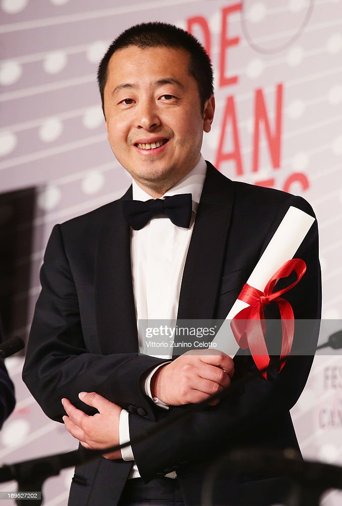 Jia Zhangke of 'Tian Zhu Ding' ('A Touch of Sin') poses with is price as he received the best screenplay award at the Palme D'Or Winners Press Conference during the 66th Annual Cannes Film Festival at the Palais des Festivals on May 26, 2013 in Cannes, France.