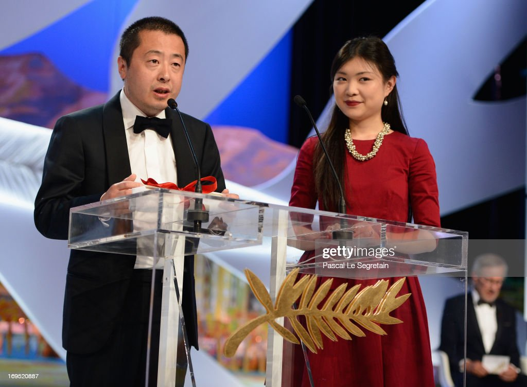 Jia Zhangke (L) of 'Tian Zhu Ding' ('A Touch of Sin') receives the best screenplay award during the Closing Ceremony during the 66th Annual Cannes Film Festival at the Palais des Festivals on May 26, 2013 in Cannes, France.