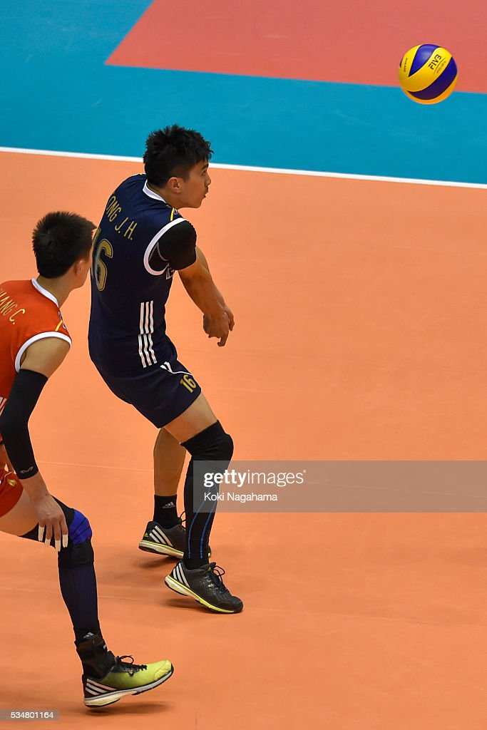 Jiahua Tong #16 of China receives the ball during the Men's World Olympic Qualification game between China and France at Tokyo Metropolitan Gymnasium on May 28, 2016 in Tokyo, Japan.
