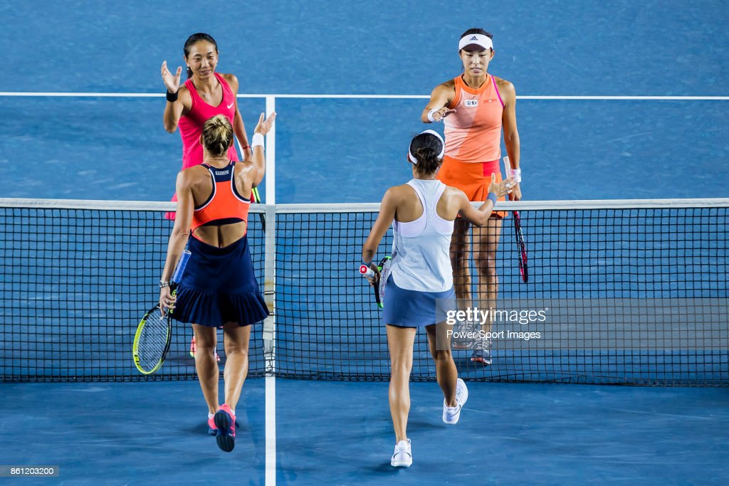 Jia-Jing Lu (top left) of China and Qiang Wang of China (top, right) are congratulated by Monique Adamczak of Australia (bottom, left) and Kai-Chen Chang of Taiwan (bottom, right) during the women's doubles semi-final match of the Prudential Hong Kong Tennis Open 2017 at Victoria Park on October 14, 2017 in Hong Kong, Hong Kong.